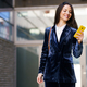 Business woman wearing blue suit using smartphone in an office building - PhotoDune Item for Sale