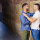 Gay couple hugging in a romantic moment outdoors - PhotoDune Item for Sale