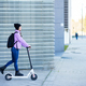 Young woman in her twenties riding an electric scooter - PhotoDune Item for Sale