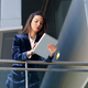Business woman wearing blue suit using digital tablet in an office building - PhotoDune Item for Sale