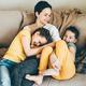 Happy mother hugs her children siblings - PhotoDune Item for Sale