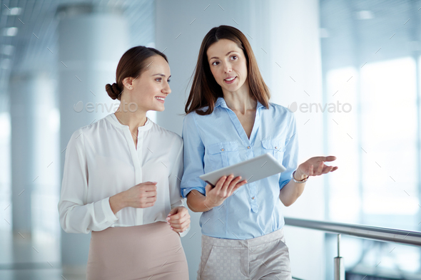 Interacting co-workers - Stock Photo - Images