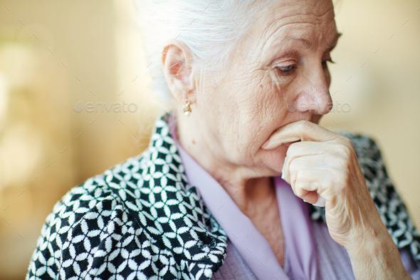 Pensive senior woman - Stock Photo - Images
