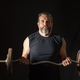 Strong, active, middle aged man with gray beard lifting heavy weights in studio setting. - PhotoDune Item for Sale