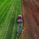 Aerial View of Tractor Plowing Field - PhotoDune Item for Sale