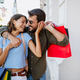 Young attractive happy couple with shopping bags outdoors - PhotoDune Item for Sale