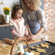 Daughter and mother  making Easter cookies at home - PhotoDune Item for Sale