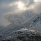 Low clouds interact with the snowy mountains - PhotoDune Item for Sale