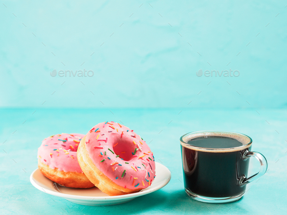 pink donuts on blue background , copy space - Stock Photo - Images