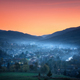 Mountain village in fog at beautiful sunset in spring - PhotoDune Item for Sale