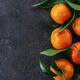 Tangerines, oranges, mandarins on black background - PhotoDune Item for Sale