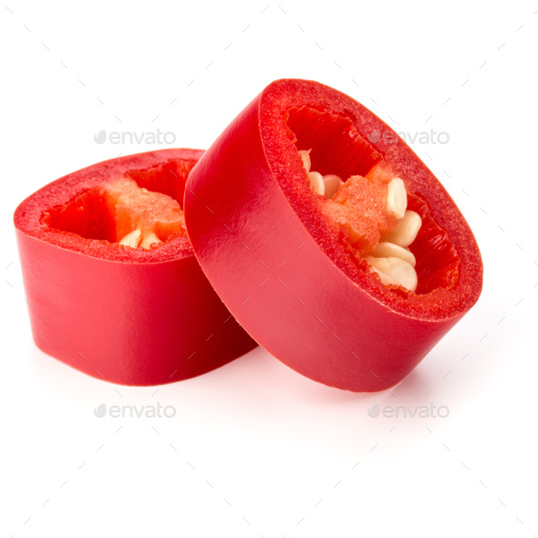 sliced red chili or chilli cayenne pepper isolated on white  background cutout - Stock Photo - Images