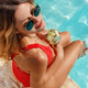 Young woman in red swimsuit with tropical cocktail - PhotoDune Item for Sale