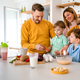 Happy family preparing healthy food together in kitchen - PhotoDune Item for Sale