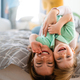 Happy little toddler boy having fun with his mother at home. Single parenting, happiness concept - PhotoDune Item for Sale