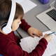 Top view of boy doing homework while e-learning - PhotoDune Item for Sale