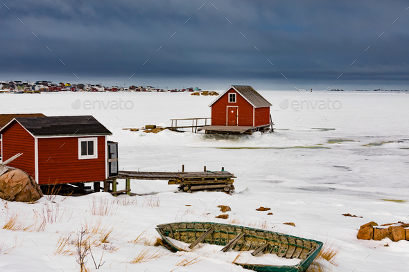 Shacks at frozen shore of Joe Batts Arm NL Canada - Stock Photo - Images