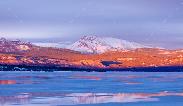 Snowy Mt Laurier frozen Lake Laberge Yukon Canada - Stock Photo - Images