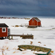 Shacks at frozen shore of Joe Batts Arm NL Canada - PhotoDune Item for Sale
