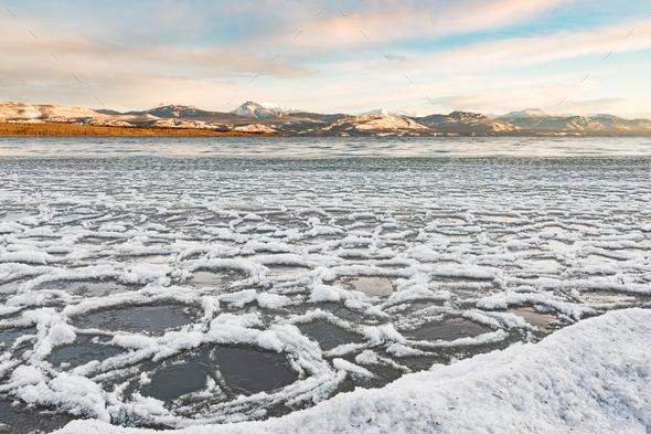 Ice floes at shore of Lake Laberge Yukon Canada - Stock Photo - Images