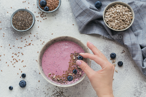 Pink Yogurt Smoothie Bowl made with Fresh Blueberry and Seeds - Stock Photo - Images