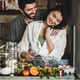 Loving couple mixing ingredients for cooking holiday pie together - PhotoDune Item for Sale