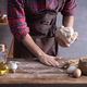Baker man kneading dough and bakery ingredients for homemade bread cooking on table - PhotoDune Item for Sale