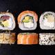 Sushi Rolls Set on Black Background. - PhotoDune Item for Sale