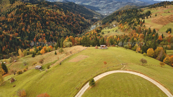 Sun mountain road aerial. Autumn nobody nature landscape. Village at mist haze. Countryside forest - Stock Photo - Images
