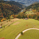 Sun mountain road aerial. Autumn nobody nature landscape. Village at mist haze. Countryside forest - PhotoDune Item for Sale