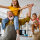 Happy grandparents having fun times with children at home - PhotoDune Item for Sale