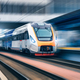 High speed train in motion on the railway station at sunset - PhotoDune Item for Sale