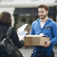 Man gives a parcel to a female client - PhotoDune Item for Sale