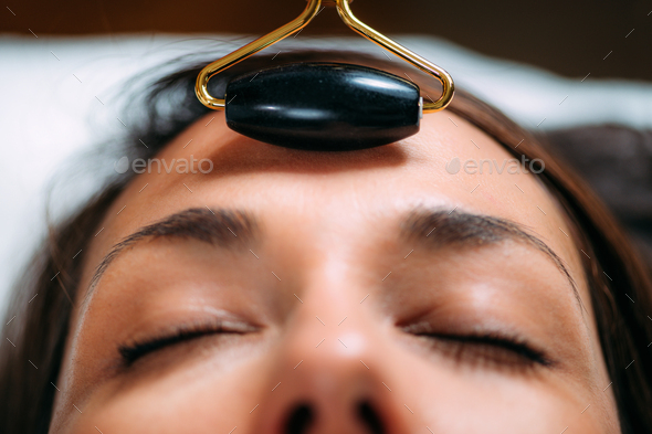 Guasha Face Massage with Jade Stone Roller - Stock Photo - Images