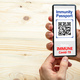 Immunity passport, coronavirus travel smartphone application on wooden background - PhotoDune Item for Sale