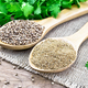 Coriander ground and seeds in two spoons on board - PhotoDune Item for Sale