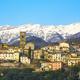 Coreglia Antelminelli village and snowy mountains on background. Garfagnana, Tuscany, Italy. - PhotoDune Item for Sale