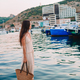 Young beautiful woman walking on dock near the boat - PhotoDune Item for Sale