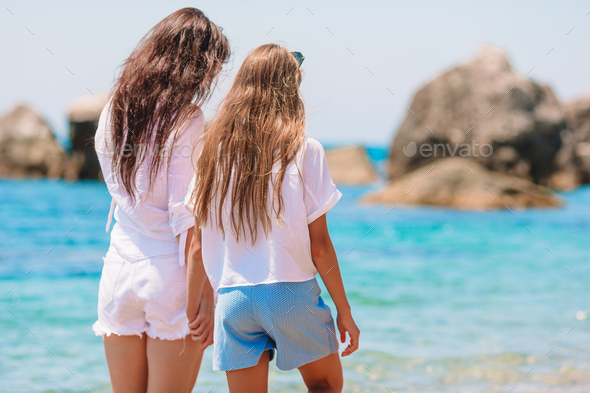 Beautiful mother and daughter at Caribbean beach enjoying summer vacation - Stock Photo - Images