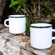 Two white campfire enamel mug mockup with tree stump - PhotoDune Item for Sale
