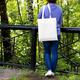 Woman in blue jumper holding tote bag mockup - PhotoDune Item for Sale