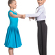 Sports ballroom dancing. Couple of kids, boy and girl  on isolated white background - PhotoDune Item for Sale
