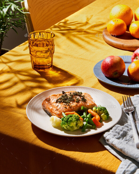 Bright food with salmon vegetables. Summer or spring sunny day or evening. Vibrant concept - Stock Photo - Images