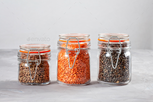 Red lentils rich in fiber and protein. Healthy food concept - Stock Photo - Images