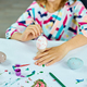 Unrecognizable little girl painting, drawing with brush eggs at home - PhotoDune Item for Sale