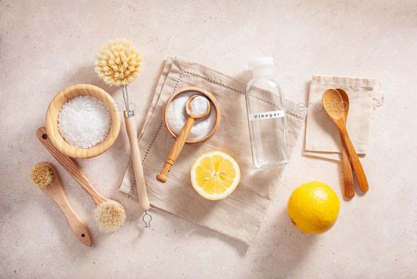 zero waste eco friendly cleaning concept. wooden brushes, lemon, baking soda, vinegar - Stock Photo - Images