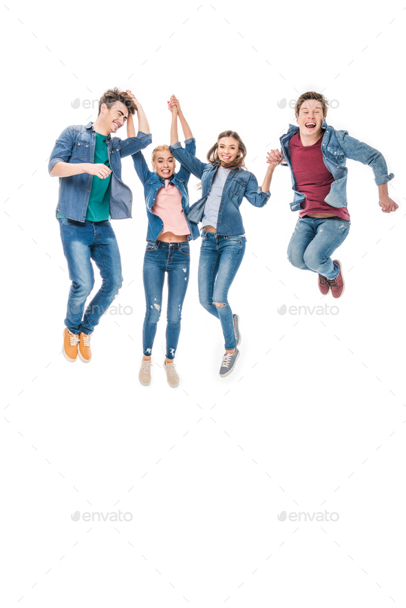 happy young friends holding hands and jumping together isolated on white - Stock Photo - Images
