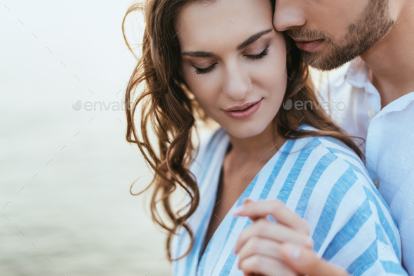 selective focus of bearded man holding hands with attractive girl - Stock Photo - Images