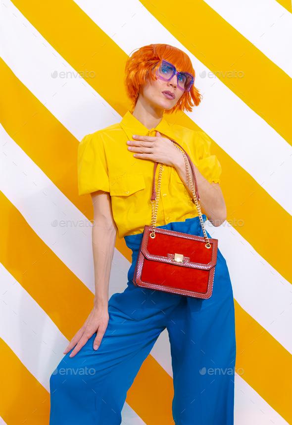 Retro Model holding bag - Stock Photo - Images
