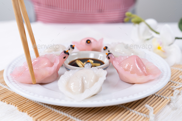 Chinese Har Gao Dim Sum dumplings in the shape of a swan - Stock Photo - Images